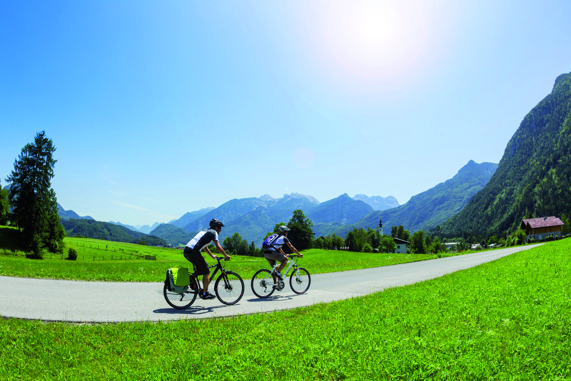 Cycling on the Tauern bike path with a view of the Hohe Tauern - cyclists will love it