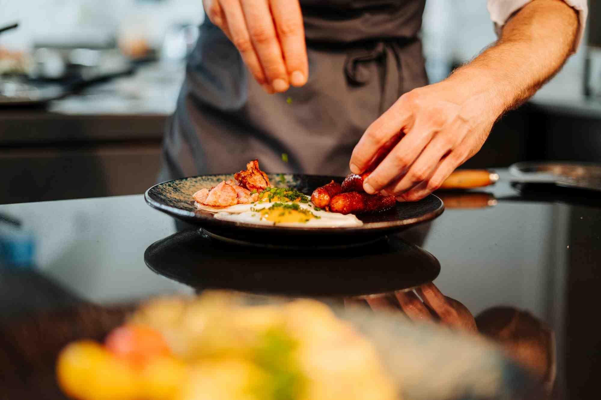 freshly prepared fried egg for breakfast in the restaurant charles hotel palais26 villach